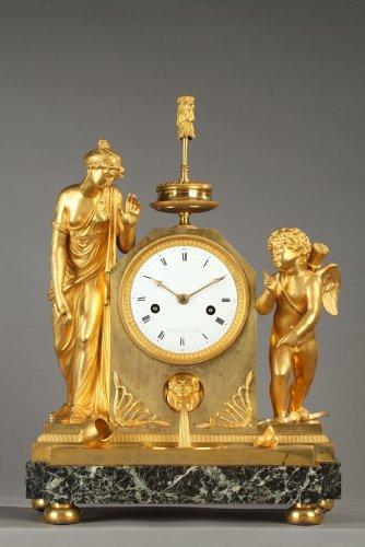 "French Empire mantel clock ""The Broken Jug"""