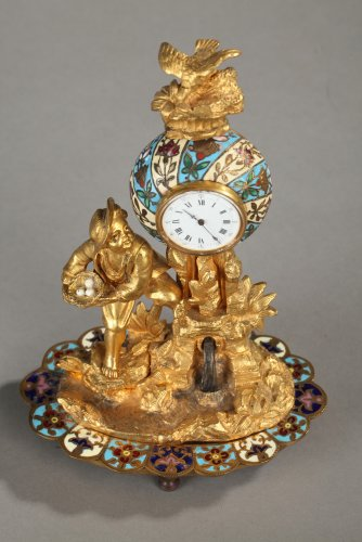 "Bronze and enamel Clock  ""Children and Bird"" -"