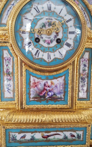 Large pendulum clock in bronze and enameled porcelain plates -