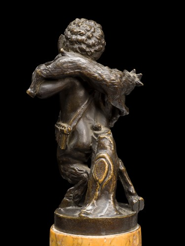 Young satyr carrying a goat -