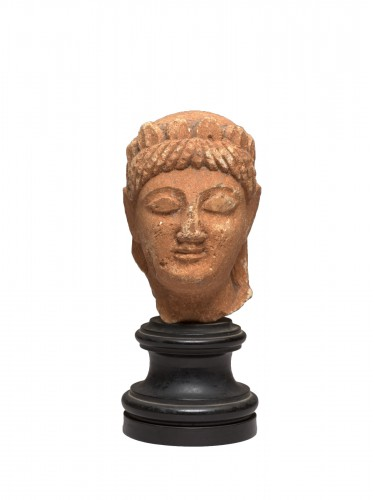 Cypriot limestone head of a female votary, late 6th-early 5th century bc