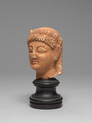 Ancient Art  - Cypriot limestone head of a female votary, late 6th-early 5th century bc