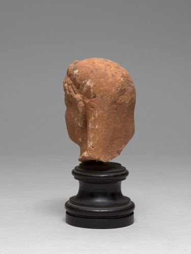 BC to 10th century - Cypriot limestone head of a female votary, late 6th-early 5th century bc