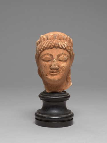 Cypriot limestone head of a female votary, late 6th-early 5th century bc -