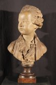 19th c bust of a young sir in terracotta, on a marble base.