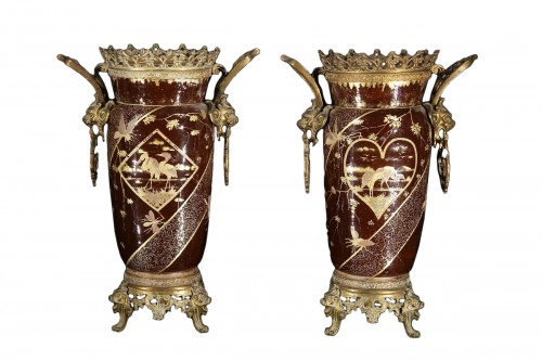 Late 19th C pair of vases in porcelain with bronze mounting.