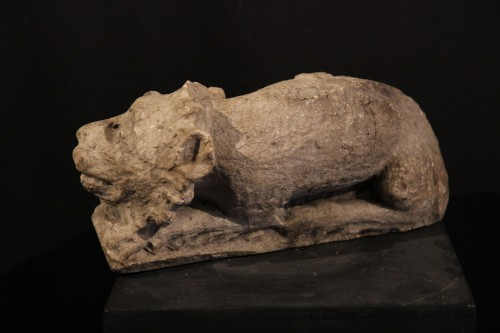 12th C Romanesque Sculpture. A lying lion, in limestone -