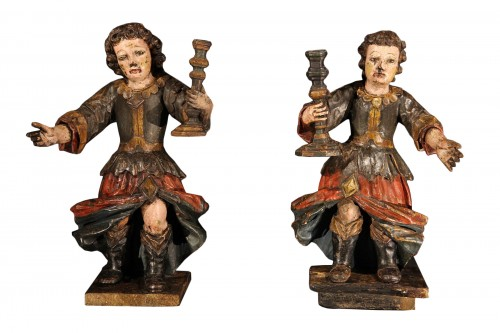17th C Pair of candle holders in carved and polychrome walnut wood