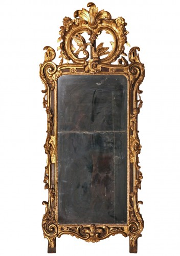 From Provence. 18th C large mirror in carved, gilt and lacquered wood.
