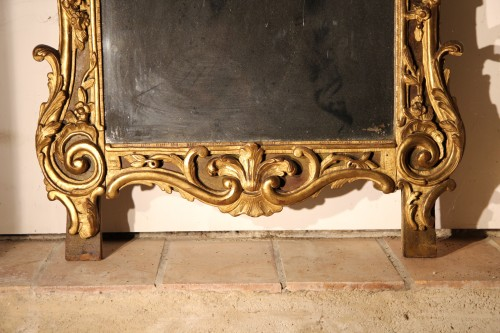 From Provence. 18th C large mirror in carved, gilt and lacquered wood. -