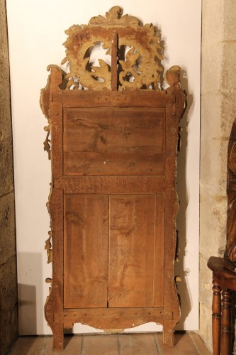18th century - From Provence. 18th C large mirror in carved, gilt and lacquered wood.