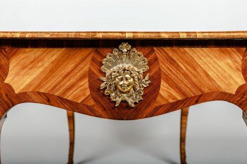 - A Louis XV style Bureau Plat