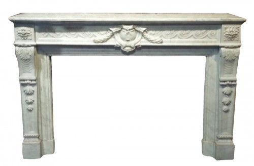 A Louis XVI style marble fireplce