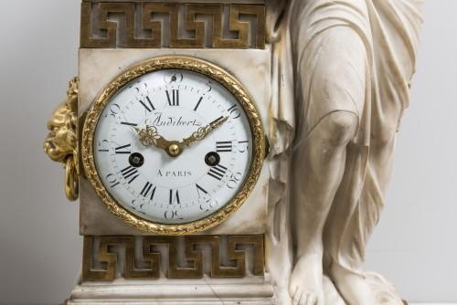 Clocks  - A Carrara marble clock on a gilded bronze base