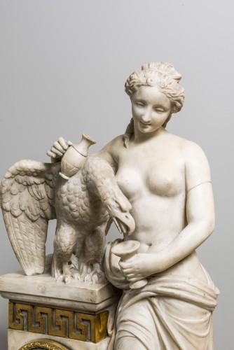 A Carrara marble clock on a gilded bronze base -