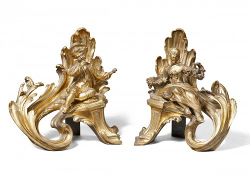 A pair of carved and gilded bronze andirons Louis XV