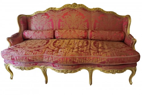 Louis XV gilded wood and red silk sofa