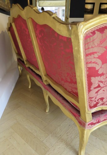 Louis XV gilded wood and red silk sofa -