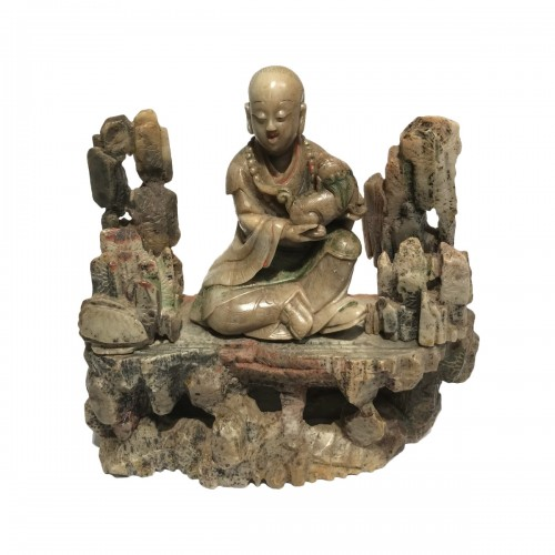 China, a soapstone figure of a Luohan, Qing period, 18th/19th century.