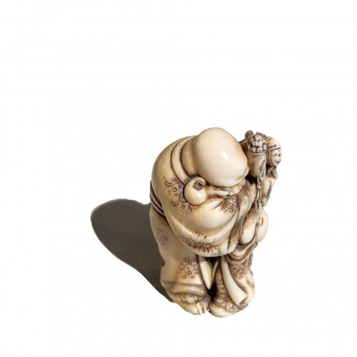 The puppeteer, netsuke by Hidemasa, Japan, Edo period, 19th c - Asian Works of Art Style