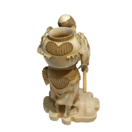 Asian Works of Art  - Japan, Ivory okimono of a man catching frogs, Meiji period, 19th century