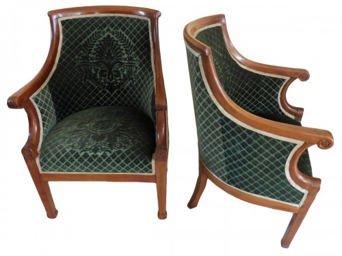 Pair of armchairs in gondola with curved back in blond mahogany.