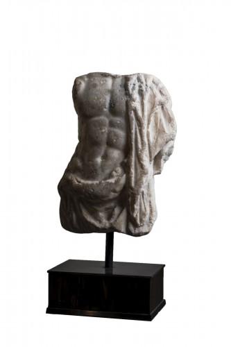 A Roman marble torso of Asklepios, circa 2nd century A.D.