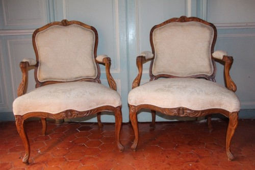 "French Regence - French Suite of four flat back fauteuils  "" la Reine"", eighteenth century"
