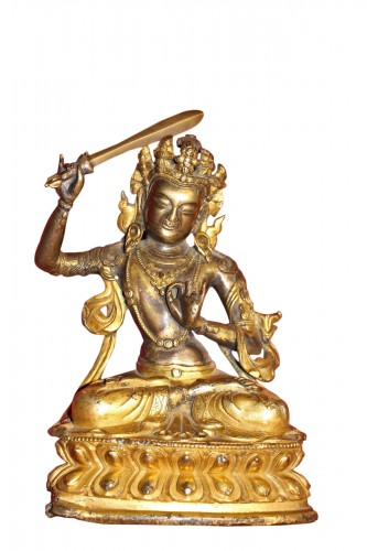 Buddha of wisdom with sword Manjushri out of gilded bronze, Tibet, at the end of XVIIe.