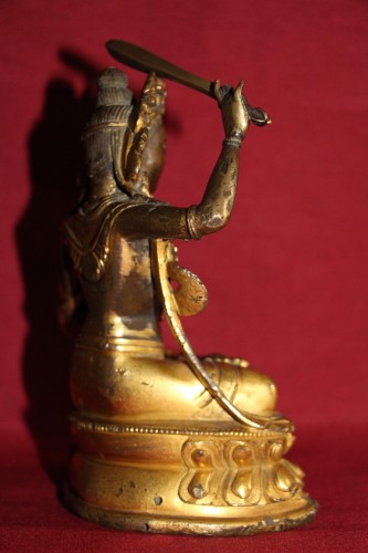 Antiquités - Buddha of wisdom with sword Manjushri out of gilded bronze, Tibet, at the end of XVIIe.