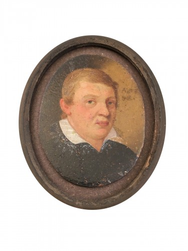 A small portrait, oil on copper, of a young man. Dated 1610.