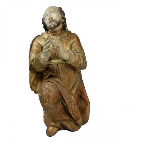 "A Baroque sculpture of a kneeling ""Saint John"" - Southern Europe (Spain?)"