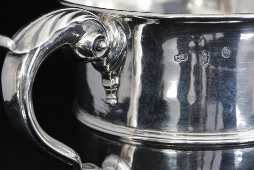 A traditional antique Irish sterling silver loving cup or two handled goble -