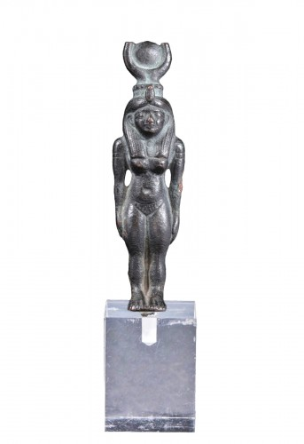 An egyptian bronze figure of Hathor