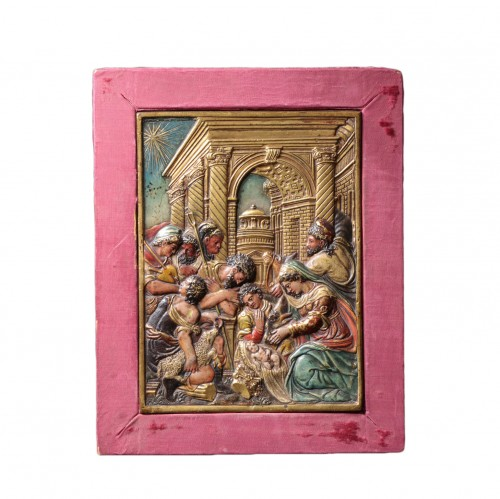 Gilt and painted bronze relief figuring the nativity