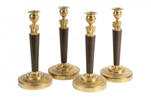 Set of four bronze candlesticks Empire period