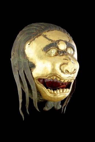 Asian Works of Art  - Tibetan Gilt Copper Repoussé Mask Head of a Ferocious Snow Lion