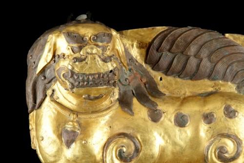 Tibetan Gilt Copper Repoussé Panel Depicting a Standing Snow Lion -
