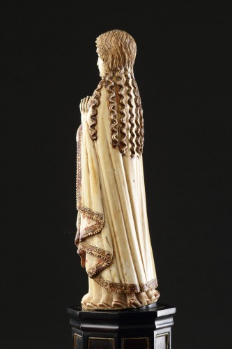 - Carved Indo-Portuguese Ivory Madonna with Hands Clasped in Prayer
