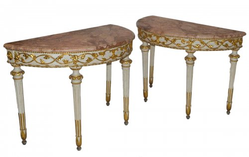 Pair of Italian, Neoclassical, painted and parcel-gilt demi-lune consoles