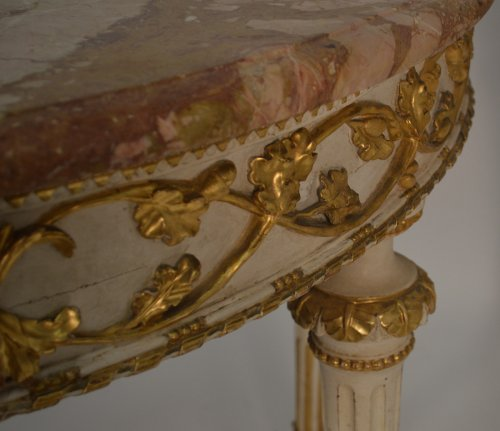 Pair of Italian, Neoclassical, painted and parcel-gilt demi-lune consoles -