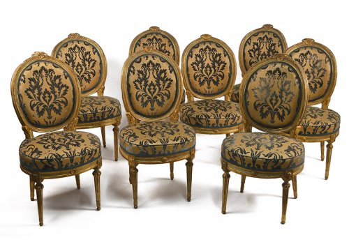 Set of eight, Northern Italian, painted and parcel-gilded dining chairs