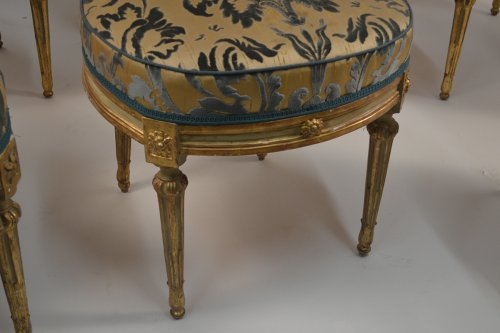 Seating  - Set of eight, Northern Italian, painted and parcel-gilded dining chairs