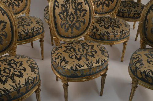 Set of eight, Northern Italian, painted and parcel-gilded dining chairs -