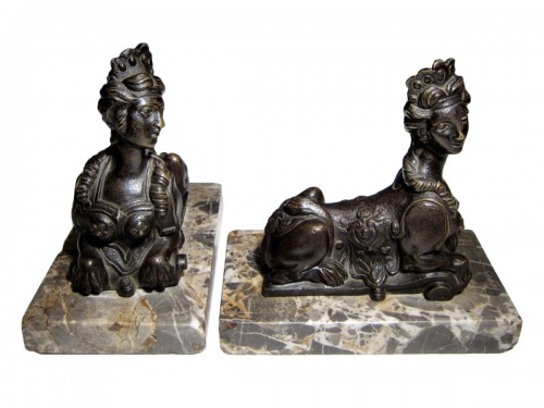A pair of French Regence bronze sphinxes