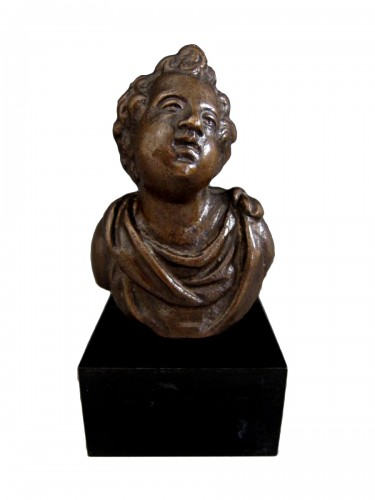 A bronze bust of a cherub, Venice, early XVIIth century