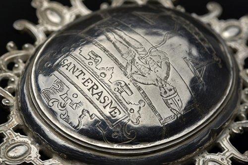 A Spanish silver reliquary medallion dedicated to Saint Erasmus, circa 1580 -