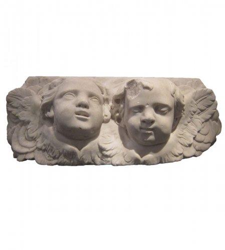 Pair of  Baroque winged angel heads, XVIIth century