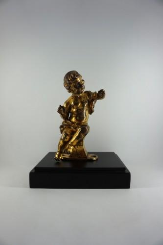 Gilt bronze figure of a Baroque cherub, 17th century -
