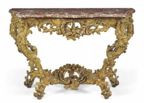 A Louis XV giltwood console table circa 1725